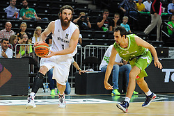 Jarrod Kenny of New Zealand vs Domen Lorbek of Slovenia during friendly match between National Teams of Slovenia and New Zealand before World Championship Spain 2014 on August 16, 2014 in Kaunas, Lithuania. Photo by Robertas Dackus / Sportida.com