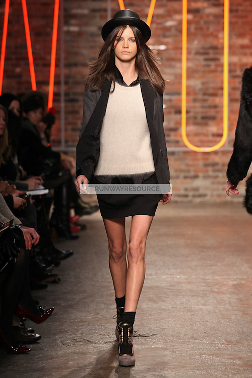 Jeisa Chiminazzo walks the runway wearing DKNY Fall 2011 Collection during Mercedes-Benz Fashion Week in New York on February 13, 2011