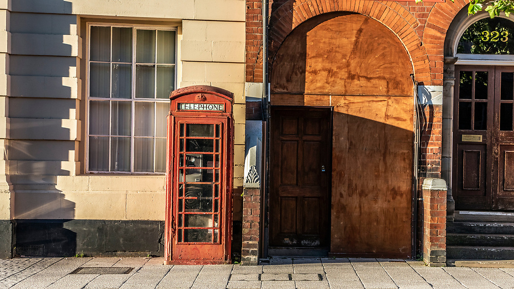 Old fashioned red telephone box. West Bromwich, West Midlands, UK.