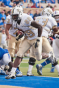Dec 1, 2012; Tulsa, Ok, USA; University of Central Florida Knights running back Latavius Murray (28) runs the ball for a touchdown during a game against the Tulsa Hurricanes at Skelly Field at H.A. Chapman Stadium. Tulsa defeated UCF 33-27 in overtime to win the CUSA Championship. Mandatory Credit: Beth Hall-USA TODAY Sports