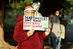 South Africa - Durban - 03 July 2020 - Coronavirus - Wentworth Grandmother Cheryl Frankson protests against children returning to school during Covid-19 outside Assegai Primary School in Wentworth<br /> Picture: Shelley Kjonstad/African News Agency(ANA)