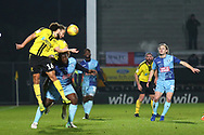 Burton Albion midfielder Marcus Harness (16) heads clear during the EFL Sky Bet League 1 match between Burton Albion and Wycombe Wanderers at the Pirelli Stadium, Burton upon Trent, England on 26 December 2018.