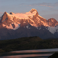 Sunrise on the Grand Tower of Paine, above Lake Pehoe in Torres del Paine National Park, Chile.
