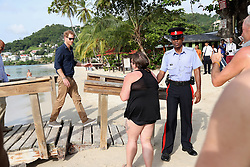 Members of the public greet Prince Harry on Grand Anse Beach in Grenada during the second leg of his Caribbean tour.