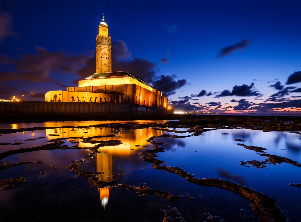 CASABLANCA, MOROCCO - CIRCA APRIL 2018: Mosque  Hassan II in Casablanca at Night as seen from the tidal pools formed by the ocean around it.