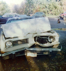 1974 Pontiac LeMans - after wreck in April 1976 parked in Browns Towing lot.<br /> <br /> A scan from an old photo or slide from the collection of Alan and Becky Look.