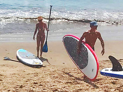 EXCLUSIVE: **STRICTLY NO WEB** Former couple Katy Perry and Orlando Bloom were spotted spending time back together over Labor Day Weekend as they hit a beach in Santa Barbara, California to go paddleboarding! The 32-year-old pop star wore a stripy Solid & Striped. bikini while the 40-year-old British actor went topless showing off his toned physique. Katy looked in great shape in her two piece swimsuit and held onto a paddle as topless Orlando carried his board into the sea. 03 Sep 2017 Pictured: Katy Perry, Orlando Bloom. Photo credit: Atlantic Images / MEGA TheMegaAgency.com +1 888 505 6342