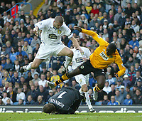 Photo. Andrew Unwin<br /> Leeds United v Blackburn Rovers, Barclaycard Premier league, Elland Road, Leeds 04/10/2003.<br /> Leeds' Mark Robinson (c) foils another attack, forcing Leeds' Dominic Matteo (l) and Blackburn's Andrew Cole (r) out of the way.