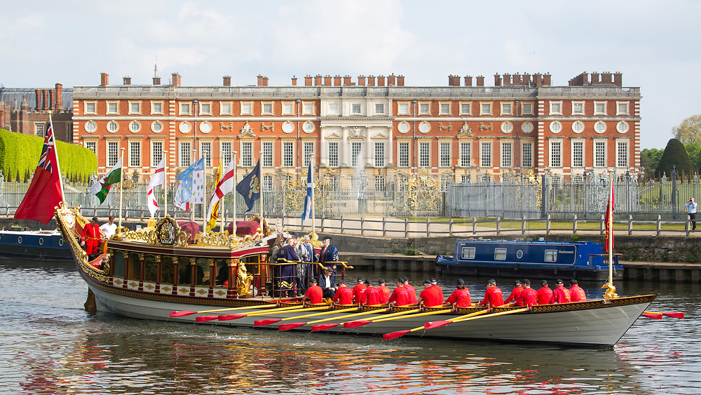 © Licensed to London News Pictures. 23/04/2017. Richmond, UK. Gloriana in the Thames at Hampton Court Palace.  The annual Tudor Pull has taken place on the River Thames with Royal Watermen rowing up the river from Hampton Court Palace to the Tower of London in the Queen's Row Barge Gloriana with a flotilla of traditional cutters behind. The 25 mile row takes place this year two days after the Queen's Birthday and on the same day at the London Marathon. Photo credit : Rob Powell/LNP
