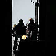 Silhoutted ski and winter subjects from the windows of Corbet's Cabin on top of Jackson Hole Mountain Resort.
