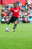 Football - 2017 / 2018 Premier League - Swansea City vs. Manchester United<br /> <br /> Antonio Valencia of Manchester United passes the ball—<br /> , at Liberty Stadium.<br /> <br /> COLORSPORT/WINSTON BYNORTH