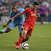 Philippe Coutinho, Liverpool, is fouled by Fernando, Manchester City, during the Manchester City Vs Liverpool FC Guinness International Champions Cup match at Yankee Stadium, The Bronx, New York, USA. 30th July 2014. Photo Tim Clayton