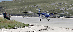 Barra Airport is a short-runway airport situated in the wide shallow bay of Traigh Mhòr at the north tip of the island of Barra in the Outer Hebrides, Scotland. Barra is now the only beach airport anywhere in the world to be used for scheduled airline services. Loganair Twin Otter taking off. c) Stephen Lawson   Edinburgh Elite media