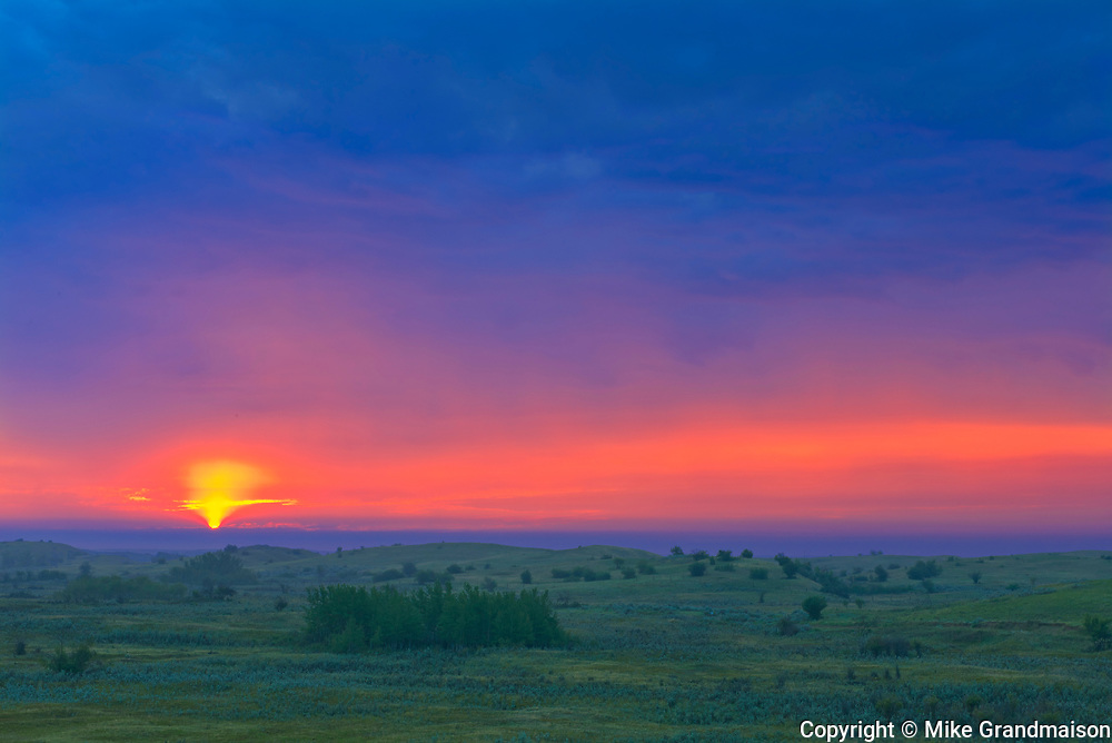 Stormy sky at dawn overlooking the prairie landscape from the top of the Great Sandhills<br />Great Sandhills<br />Saskatchewan<br />Canada