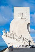 Tourists visit monument to Henry the Navigator and fellow travellers in Lisbon, Portugal