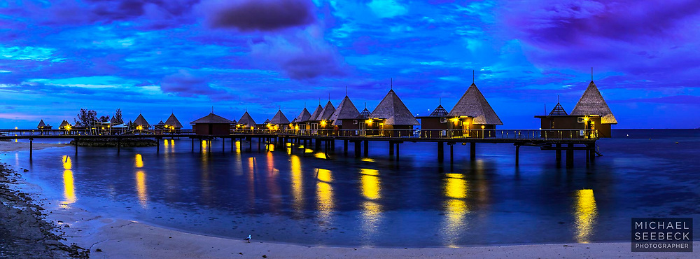 Early morning twilight over jetty bungalows at Ilot Maitre Resort, New Caledonia.<br /> <br /> Limited Edition of 125