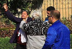 December 10, 2016 - Cairo, Cairo, Egypt - A relative of one of the blast victims reacts at the scene of a bomb explosion at the Saint Peter and Saint Paul Coptic Orthodox Church on December 11, 2016, in Cairo's Abbasiya neighbourhood. The blast killed at least 25 worshippers during Sunday mass inside the Cairo church near the seat of the Coptic pope who heads Egypt's Christian minority, state media said  (Credit Image: © Amr Sayed/APA Images via ZUMA Wire)