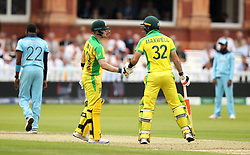 Australia's Steve Smith (left) and Glenn Maxwell (right) touch gloves during the ICC Cricket World Cup group stage match at Lord's, London.
