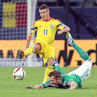 ROMANIA, Bucharest : Romania's Gabriel Torje (L) and Northern Ireland's Sammy Clingan (R) vie for the ball during the Euro 2016 Group F qualifying football match Romania vs Northern Ireland in Bucharest, Romania on November 14, 2014.