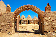 """Pictures of the beehive adobe buildings of Harran, south west Anatolia, Turkey.  Harran was a major ancient city in Upper Mesopotamia whose site is near the modern village of Altınbaşak, Turkey, 24 miles (44 kilometers) southeast of Şanlıurfa. The location is in a district of Şanlıurfa Province that is also named """"Harran"""". Harran is famous for its traditional 'beehive' adobe houses, constructed entirely without wood. The design of these makes them cool inside. 11 .<br /> <br /> If you prefer to buy from our ALAMY PHOTO LIBRARY  Collection visit : https://www.alamy.com/portfolio/paul-williams-funkystock/harran.html<br /> <br /> Visit our TURKEY PHOTO COLLECTIONS for more photos to download or buy as wall art prints https://funkystock.photoshelter.com/gallery-collection/3f-Pictures-of-Turkey-Turkey-Photos-Images-Fotos/C0000U.hJWkZxAbg ."""