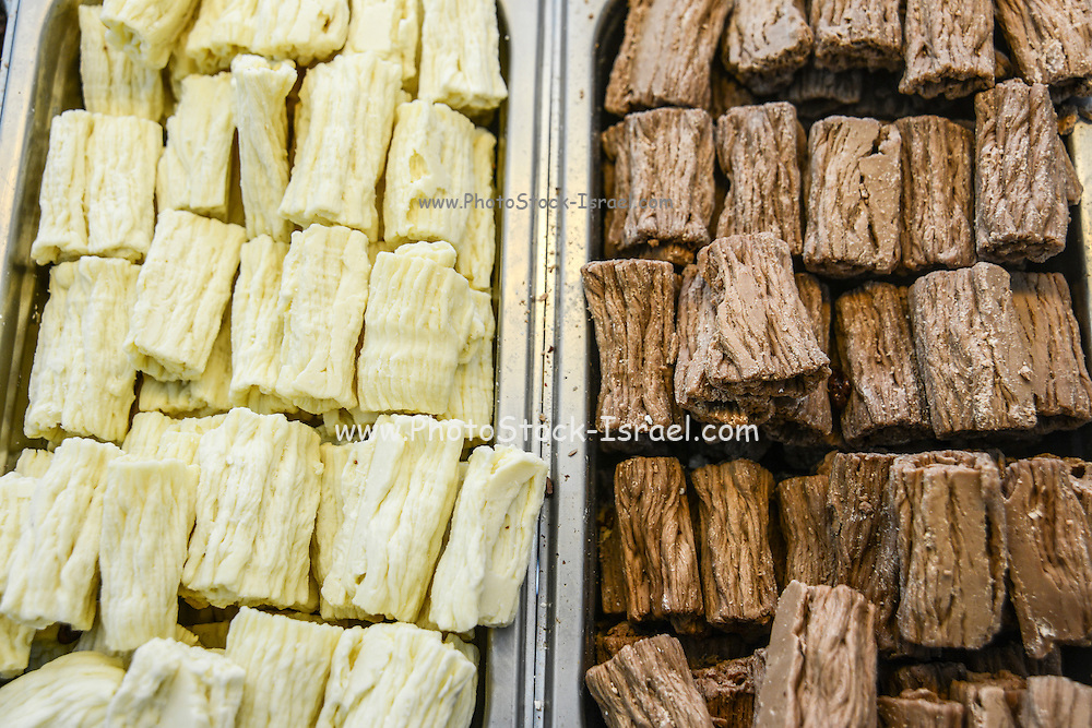 white and milk Chocolate logs or chocolate flakes