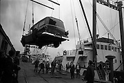 """25/06/1963<br /> 06/25/1963<br /> 25 June 1963<br /> Ford station wagon Ambulance being unloaded from the ship the """"City of Cork"""" at the North Wall, Dublin port. Image shows the ambulance being lowered onto the quay by the ship's derrick."""