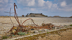 Scrap metal from demolished infrastructure litters the surroundings to the derelict buildings at the former Atomic Weapons Research Establishment at Orford Ness in Suffolk.