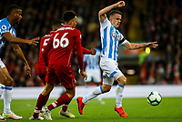 Huddersfield Town's Jonathan Hogg gets away from Liverpool's Trent Alexander-Arnold and Georginio Wijnaldum<br /> <br /> Photographer Alex Dodd/CameraSport<br /> <br /> The Premier League - Liverpool v Huddersfield Town - Friday 26th April 2019 - Anfield - Liverpool<br /> <br /> World Copyright © 2019 CameraSport. All rights reserved. 43 Linden Ave. Countesthorpe. Leicester. England. LE8 5PG - Tel: +44 (0) 116 277 4147 - admin@camerasport.com - www.camerasport.com