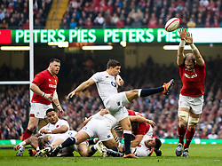 Ben Youngs of England clears despite the attentions of Alun Wyn Jones of Wales<br /> <br /> Photographer Simon King/Replay Images<br /> <br /> Six Nations Round 3 - Wales v England - Saturday 23rd February 2019 - Principality Stadium - Cardiff<br /> <br /> World Copyright © Replay Images . All rights reserved. info@replayimages.co.uk - http://replayimages.co.uk
