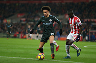 Leroy Sane of Manchester City (l) goes past Badou Ndiaye of Stoke City. Premier league match, Stoke City v Manchester City at the Bet365 Stadium in Stoke on Trent, Staffs on Monday 12th March 2018.<br /> pic by Andrew Orchard, Andrew Orchard sports photography.