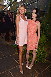 Left to right, Bryony Bowes and Ella Catliff at The Ivy Chelsea Garden Summer Party, Kings Road, London, England. 14 May 2018.