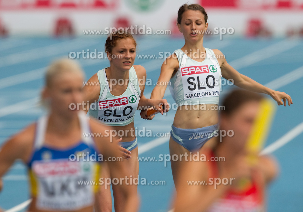 Liona Rebernik competes as a second and Anja Puc as first Slovenia athlete during  the 4x400m Womens Relay Heats during day five of the 20th European Athletics Championships at the Olympic Stadium on July 31, 2010 in Barcelona, Spain.  (Photo by Vid Ponikvar / Sportida)