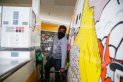 © Licensed to London News Pictures. 30/09/2020. London, UK. Franklyn Owusu fills his van at a Shell petrol station in London. Royal Dutch Shell Plc will cut up to 9,000 jobs as part of a major overhaul to shift the oil and gas giant to low-carbon energy. Shell will cut the dividend payments to its shareholder for the first time since World War 2. Photo credit: Dinendra Haria/LNP