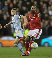 Leeds United's Liam Cooper in action with Nottingham Forest's Lewis Grabban<br /> <br /> Photographer Mick Walker/CameraSport<br /> <br /> The EFL Sky Bet Championship - Nottingham Forest v Leeds United - Saturday 8th February 2020 - The City Ground - Nottingham <br /> <br /> World Copyright © 2020 CameraSport. All rights reserved. 43 Linden Ave. Countesthorpe. Leicester. England. LE8 5PG - Tel: +44 (0) 116 277 4147 - admin@camerasport.com - www.camerasport.com
