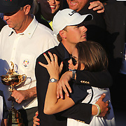 Ryder Cup 2016. Day Three. Jordan Spieth and his partner Annie Verret  as the United States team players and their spouses and partners celebrate with the Ryder Cup after the United States victory in the Ryder Cup tournament at Hazeltine National Golf Club on October 02, 2016 in Chaska, Minnesota.  (Photo by Tim Clayton/Corbis via Getty Images)