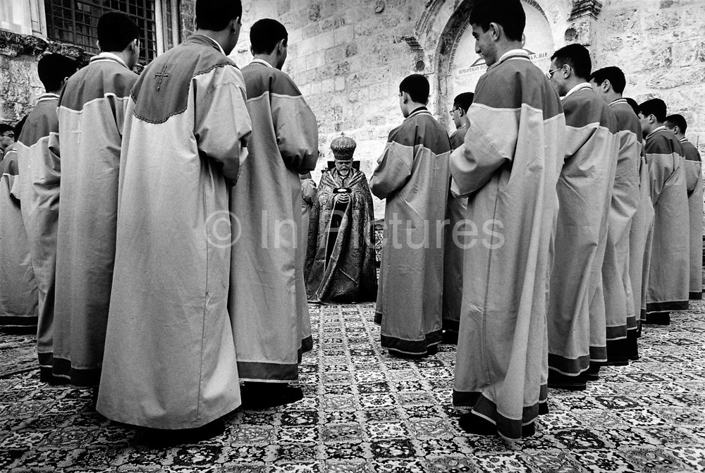 The Patriarch of the Armenian Orthodox Church, Torkom Manoogian and priests. Jerusalem, Israel