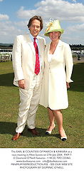 The EARL & COUNTESS OF MARCH & KINRARA at a race meeting in West Sussex on 27th July 2004.PXM 7