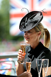 Racegoers enjoy refreshments during day five of Royal Ascot at Ascot Racecourse.