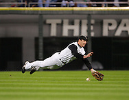CHICAGO - OCTOBER 11:  Aaron Rowand #33 of the Chicago White Sox makes an diving attempt to catch Darin Erstad's single in the 7th inning during Game 1 of the American League Championship Series against the Chicago White Sox at U.S. Cellular Field on October 11, 2005 in Chicago, Illinois.  The Angels defeated the White Sox 3-2.