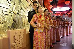 January 2, 2018 - Liaochen, Liaochen, China - Young couples..Young couples hold a group wedding in Liaocheng, east China's Shandong Province, January 2nd, 2017. (Credit Image: © SIPA Asia via ZUMA Wire)