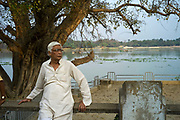 An old man sits on the Strand by the Hooghley River in Chandannagar, India