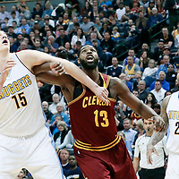 22 March 2017: Cleveland Cavaliers center Tristan Thompson (13) vies for the rebound with Denver Nuggets forward Nikola Jokic (15) and Denver Nuggets forward Wilson Chandler (21) during the Denver Nuggets 126-113 victory over the Cleveland Cavaliers, at the Pepsi Center, Denver, Colorado, USA.
