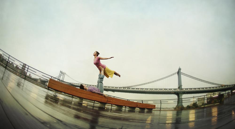 Meryl Bezrutczyk & Minhee Cha in front of Manhattan Bridge, New York<br /> <br /> Yoga in New York Project. <br /> Sponsored by Yoga Journal and Hanuman Clothing Yoga in New York Project. <br /> In partnership with Yoga Journal Conferences and Hanuman Yoga Clothing