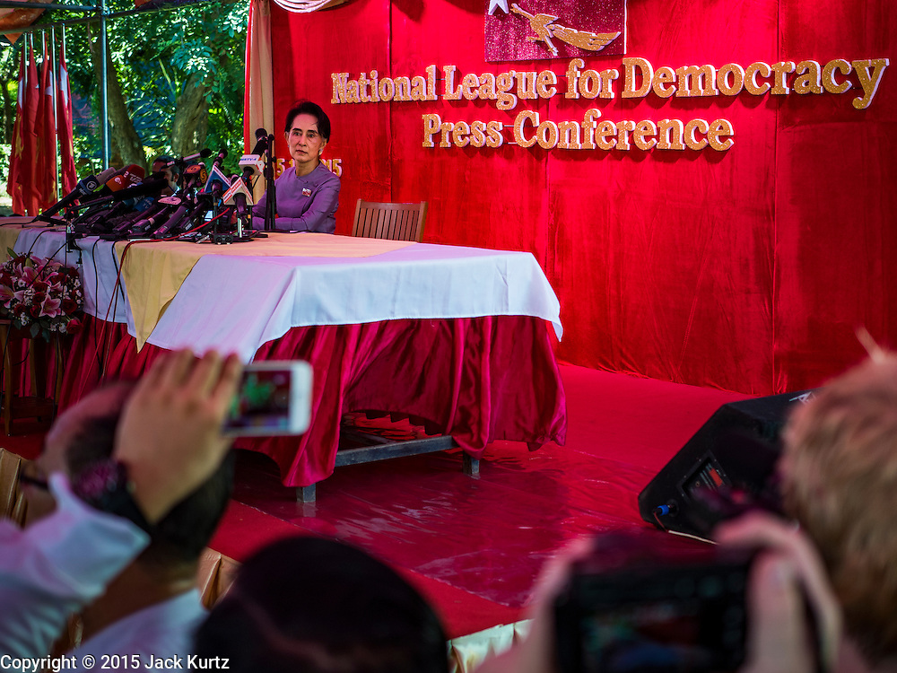 """05 NOVEMBER 2015 - YANGON, MYANMAR: AUNG SAN SUU KYI answers reporters' questions during a press conference. During the press conference, which lasted 90 minutes, Aung San Suu Kyi, the leader of the National League for Democracy (NLD), said that if the NLD won the election she would serve """"above"""" the President. When questioned about the Rohingya crisis in western Myanmar, a reporter called the situation """"dramatic"""" and Suu Kyi replied the entire country is in a """"dramatic situation"""" and the problems of the Rohingya should not be """"exaggerated."""" She said the """"great majority of our people remain as poor as ever."""" She also said the NLD would make a """"fuss"""" if election results were """"suspicious."""" Citizens of Myanmar go to the polls Sunday November 8 in what is widely viewed as the most democratic and contested election in Myanmar's history. The NLD is widely expected to win the election.   PHOTO BY JACK KURTZ"""