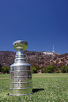11 July 2007:  NHL Hockey Hall of Fame Stanley Cup Trophy was escorted around to Los Angeles Landmarks on Wednesday on a photo tour, courtesy of the winning NHL Anaheim Ducks hockey team as part of a summer celebration.  Seen here at a park below the famous Hollywood sign in Hollywood hills on a clear summer day.