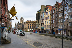 Edinburgh, Scotland, UK. 14 November 2020. Views of Edinburgh city centre on Saturday afternoon during a level 3 lockdown imposed by the Scottish Government;.Pictured; The Royal Mile at Lawnmarket is almost deserted with few tourists. Iain Masterton/Alamy Live News.