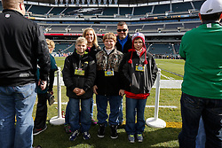 EYP Guests pose for a picture on the sideline before the NFL game between the Philadelphia Eagles and the New York Giants on Sunday, October 27th 2013 in Philadelphia. (Photo by Brian Garfinkel)
