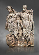 Roman Sebasteion relief  sculpture of Nero being crowned emperor by Agrippina, Aphrodisias Museum, Aphrodisias, Turkey.  Against a grey background.<br /> <br /> Agrippina crowns her young son Nero with a laurel wreath. She carries a cornucopia, a symbol of Fortune and Plenty, and he wears the armour and cloak of a Roman commander, with a helmet on the ground near his feet. The scene refers to Nero's accession as emperor in AD 54, and belongs before AD 59 when Nero had Agrippina murdered. .<br /> <br /> If you prefer to buy from our ALAMY STOCK LIBRARY page at https://www.alamy.com/portfolio/paul-williams-funkystock/greco-roman-sculptures.html . Type -    Aphrodisias     - into LOWER SEARCH WITHIN GALLERY box - Refine search by adding a subject, place, background colour, museum etc.<br /> <br /> Visit our ROMAN WORLD PHOTO COLLECTIONS for more photos to download or buy as wall art prints https://funkystock.photoshelter.com/gallery-collection/The-Romans-Art-Artefacts-Antiquities-Historic-Sites-Pictures-Images/C0000r2uLJJo9_s0