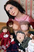 Body art - female model with porcelain dolls