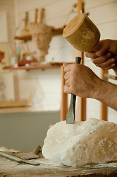 Mature man carving soapstone